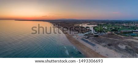 Aerial sunset seascape of Salgados beach in Albufeira, Algarve tourism destination region, Portugal. #1493306693