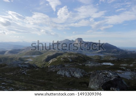 FESTVAG, NORDLAND COUNTY / NORWAY - SEPTEMBER 01 2019: Amazing view with Norway mountains. View from the Finnkonnakken slope to the Steigtind mountain peak. Sjunkhatten National Park, Norway #1493309396