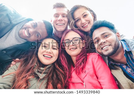 Happy friends from diverse cultures and races taking selfie - Students having fun with technology trends at erasmus university - Youth, tech and friendship concept  - Main focus on bottom girls #1493339840