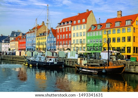 Colorful waterfront buildings and ships along the historic Nyhavn canal with reflections, Copenhagen, Denmark #1493341631