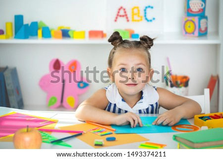 Preparation for school. Early education. Little girl is educated at home.