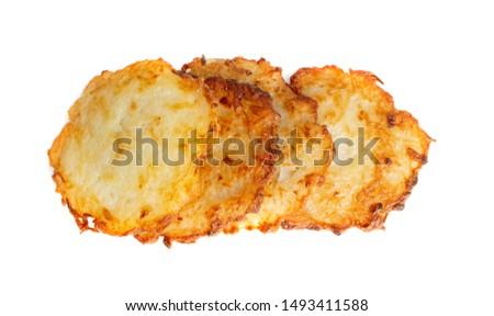 Potato pancakes, draniki, deruny, potato latkes, latkas, irish cakes, raggmunk or boxties isolated on white background. Fried grated potato pancakes or potato fritter with onion and seasoning #1493411588
