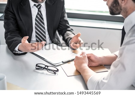 Business people negotiating a contract. Human hands working with documents at desk and signing contract. #1493445569