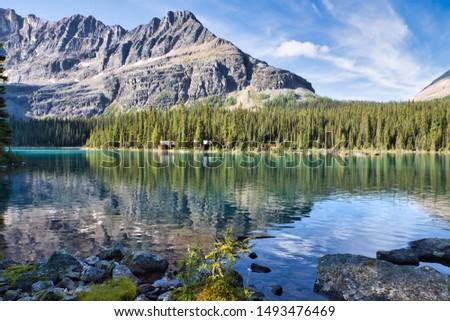 Beautiful Lake O'Hara villa against the Mount Shaffer on a summer morning. #1493476469