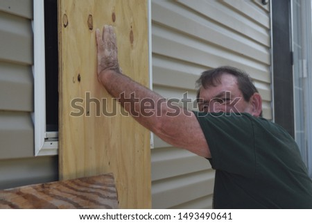 HURRICANE DORIAN: Boca Raton, South Florida, September 1, 2019 - Resident Prepare Homes for HURRICANE DORIAN  #1493490641