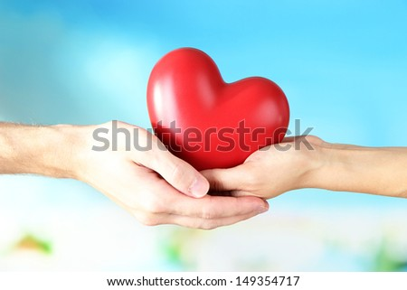 Heart in hands on cloud background #149354717