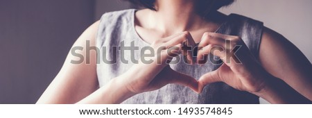 Woman making hands in heart shape, heart health insurance, social responsibility, donation, happy charity volunteer concept, world heart day, International Day of Sign Languages, organ donor day #1493574845