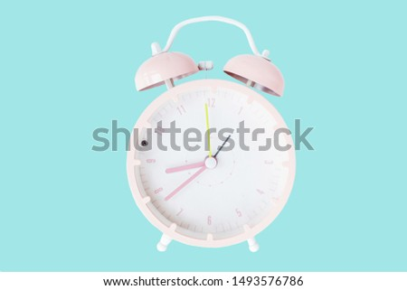 Vintage alarm clock pink color Isolated on trendy blue background. Rest hours time of life good. Flat lay, top view, copy space, mockup, overhead #1493576786