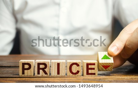 A man changes the position of a block with symbols of growth and decline near the word Price. Price regulator, supply-demand balance, market laws. Economics and free commerce. Planned Economy. #1493648954