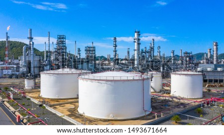 Oil​ refinery​ and​ petrochemical​ architecture plant industrial with blue sky background, White oil and gas refinery tank, Oil refinery plant from industry zone business power and energy petroleum. #1493671664