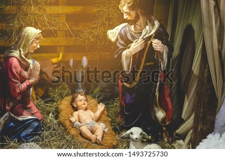 Christmas nativity scene represented with porcelain figures of Mary, Joseph and baby Jesus. nativity scene. Selective focus, noise effect #1493725730