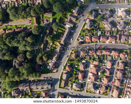 Aerial photo of the UK town known as Pontefract, located in Wakefield West Yorkshire, showing typical British housing estates with roads and paths.