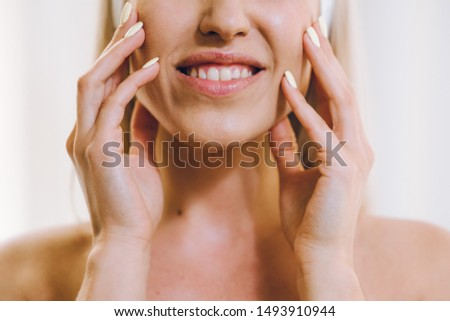 Face massage. Close-up of young woman getting spa massage treatment at beauty spa salon.Spa skin and body care. Facial beauty treatment.Cosmetology.  #1493910944