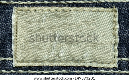 Blank leather jeans label sewed on a jeans. Can be used as background for your text.  #149393201