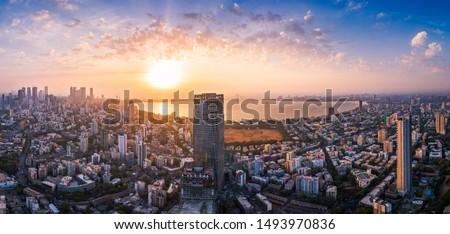View of Mumbai showing the Bandra Worli Sea Link in the centre passing over the Mahim Bay, with the city around it. Dadar, Prabhadevi, Lower Parel, Worli, Matunga, Mahim and Bandra can be seen. #1493970836