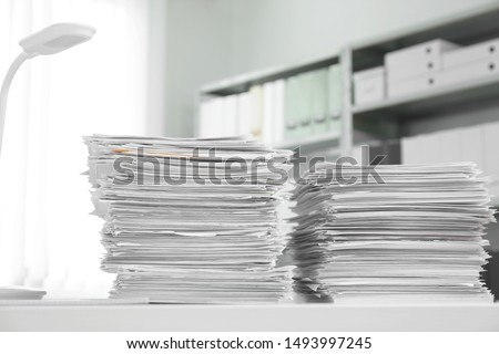 Stacks of documents on table in office #1493997245