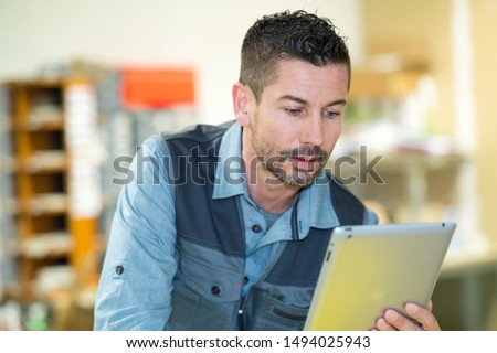 man with tablet pc computer #1494025943
