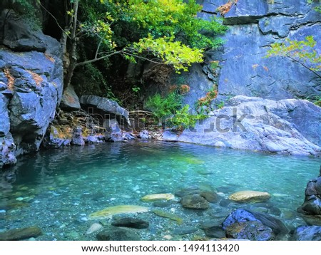 Turquoise water and huge rock inside canyon #1494113420