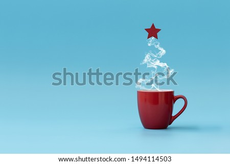Christmas tree made of steaming coffee with red star. Morning drink. Christmas or New Year celebration concept. Copy space.