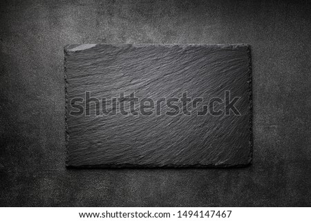 Black slate board on dark stone texture top view. Empty space for menu or recipe. #1494147467