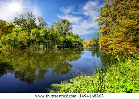 Blue river or lake with green trees on the shore. The bright summer sun. The concept of ecological clean green planet, nature, travel and solitude #1494168863
