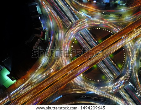 Aerial view of circle road traffic in roundabout and highway at night, Expressway, Modern transportation, Multilevel junction highway, Important infrastructure of transport, Top view. #1494209645