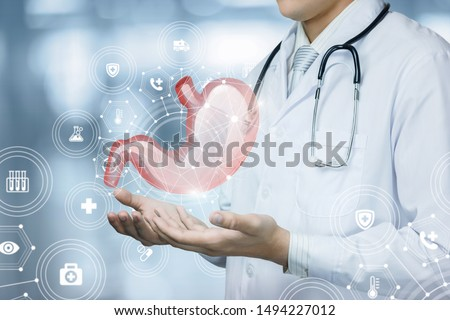 The doctor shows the patient stomach on blurred background.The doctor shows the patient stomach on blurred background. #1494227012
