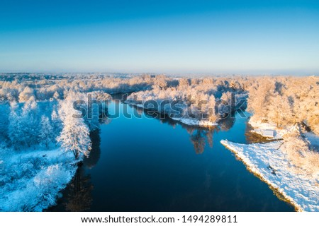 Winter landscape with river and snowy forest. Clear winter morning. Sunny nature. #1494289811