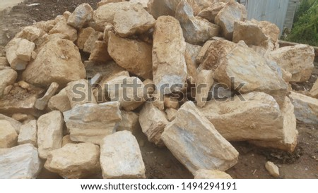 Stones piled up for the use in roadside construction. #1494294191