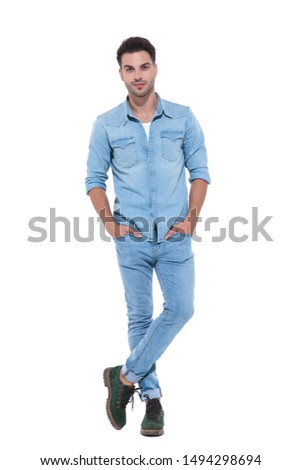 attractive young man posing with hands in his pockets and standing on white background; full body; full length #1494298694