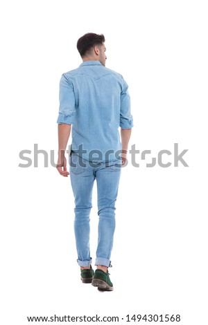 back view of young man walking and looking to side, standing isolated on white background, full body, full length #1494301568