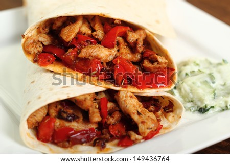 Tortilla with chicken, bell pepper and tzatziki #149436764