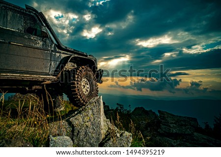 Offroad car on mountain road. Shock absorber for off road car. Car brakes with absorbers. Car tire. Tire for offroad #1494395219