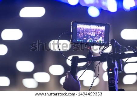 LAS VEGAS - AUGUST 3, 2019: Camera man operating wireless stabilized recording equipment at eSports fighting game tournament EVO 2019 Evolution Championship Series at Mandalay Bay Events Center. #1494459353
