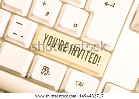 Handwriting text You Re Invited. Concept meaning make a polite friendly request to someone go somewhere White pc keyboard with empty note paper above white background key copy space. #1494482717