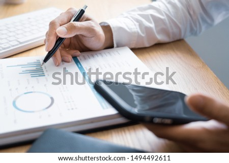 Work process concept, Business man using mobile phone writing in agenda consulting on a desk at home or office #1494492611