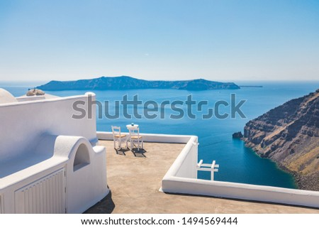 Romantic luxury resort terrace view with chairs and table for couples. Relaxation scenery as luxurious summer vacation and holiday destination in white architecture view. Idyllic travel destination #1494569444