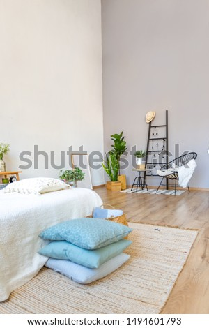 large room with Scandinavian interior. Close up view with resting area. wooden floor and grey walls #1494601793