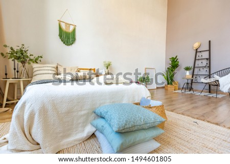 large room with Scandinavian interior. Close up view with resting area. wooden floor and grey walls #1494601805
