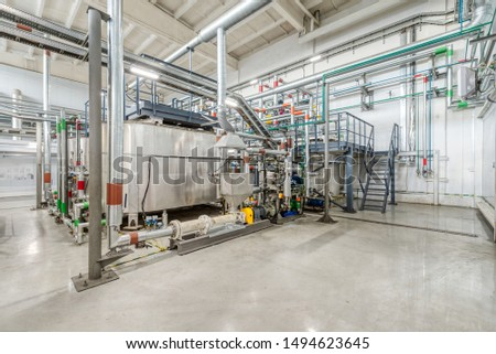 Production of chemical emulsions for mining. Clean chemical workshop. Many different pipelines and tanks. A lot of clean and shiny pipelines, taps, valves. #1494623645