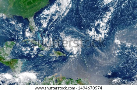 Satellite view of an hurricane approaching to USA.Elements of this image furnished by NASA. Royalty-Free Stock Photo #1494670574