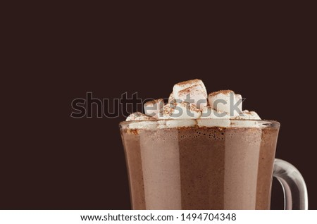 Winter hot drink cocoa with marshmallows, cocoa powder closeup, details, top section on dark brown wall, copy space. #1494704348