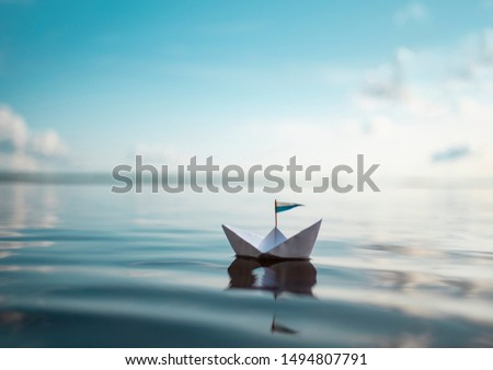 Small Paper Boat is floating on Calm Water #1494807791