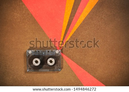 Vintage music cassette tape on retro background. Flat lay with copy space. 70's, 80's, 90's old school record technology.