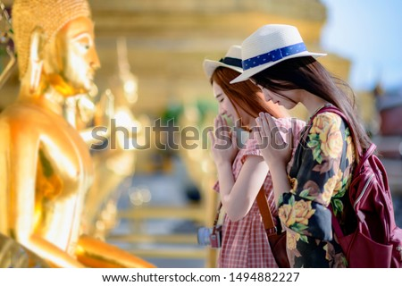 young woman tourist praying pay respect to Buddha statue in the palace temple in Bangkok of Thailand, Emerald Buddha Temple, Wat Phra Kaew, Bangkok Royal Palace popular tourist place #1494882227