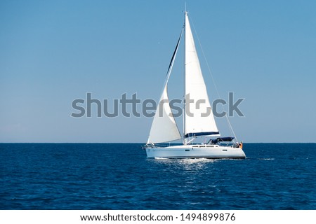 a sailingboat at sea outside the coast of Corsica Royalty-Free Stock Photo #1494899876