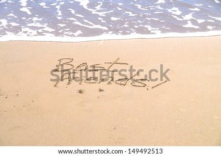 """best friends,"" a message written in the sand"