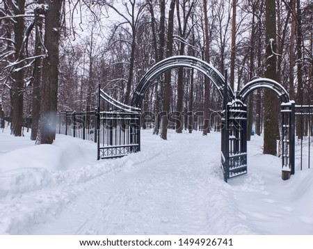 Open gates to snow covered city park #1494926741