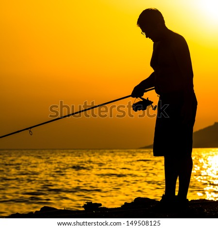 Fisherman silhouette on the beach at colorful sunset #149508125