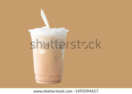 pouring milk  and Iced or frappe coffee cup on glass cup isolated  brown background #1495094657